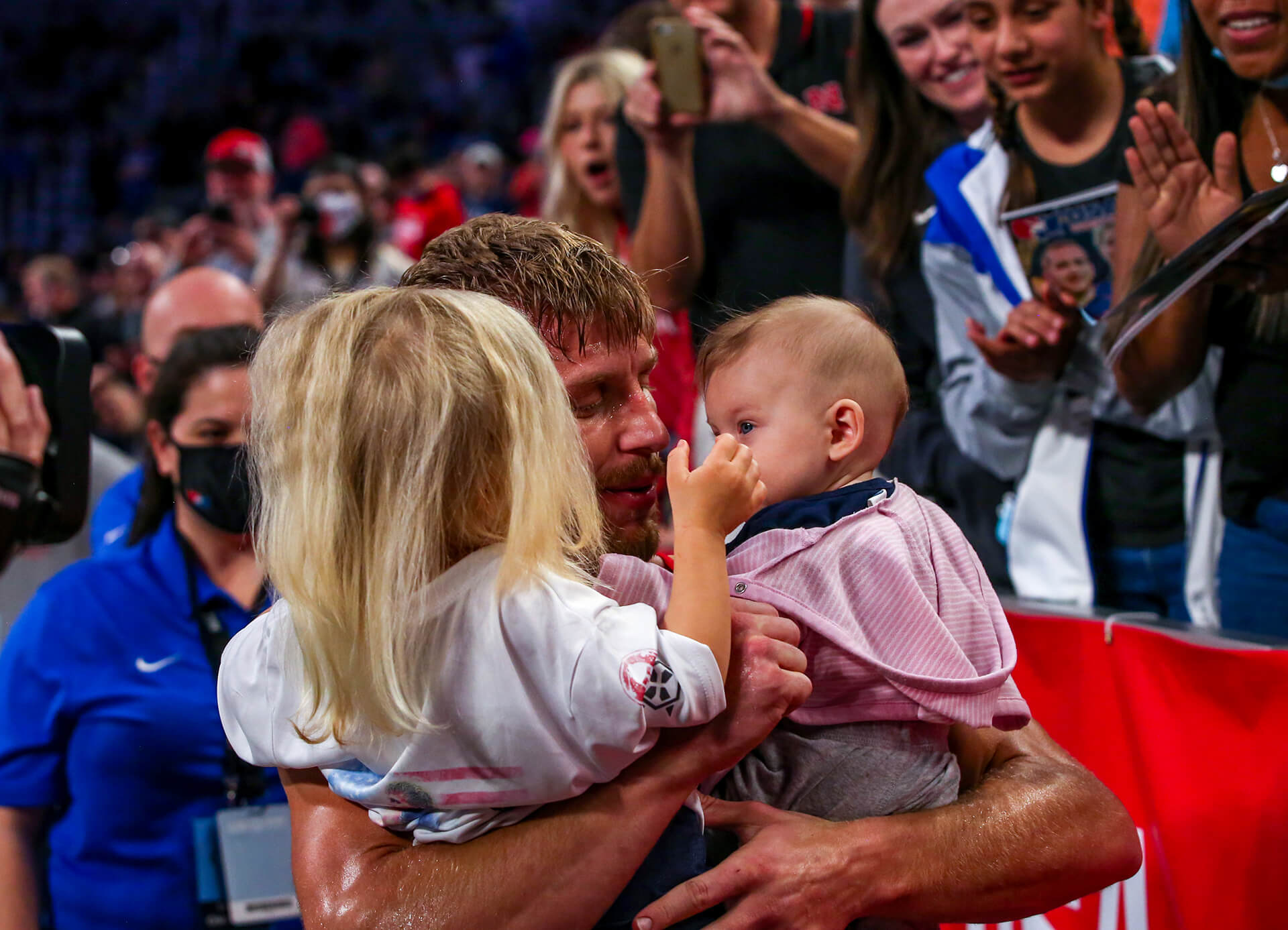 Kyle holding his two daughters
