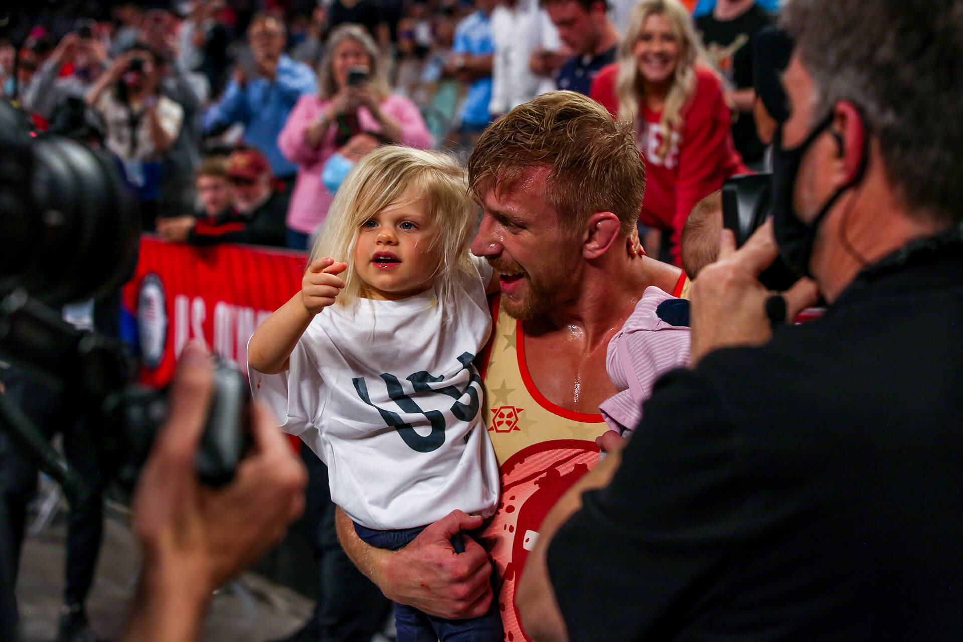 Kyle holding his daughter
